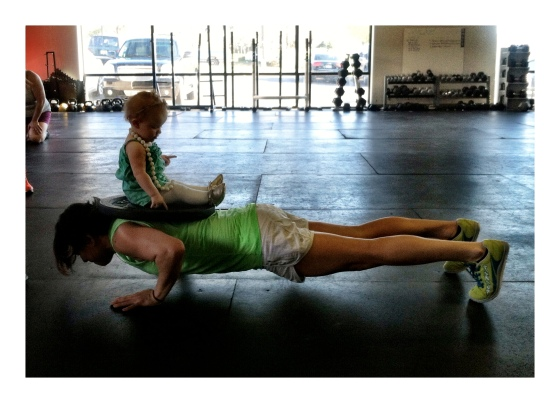 Kenz helping Mary with her weighted push-ups!