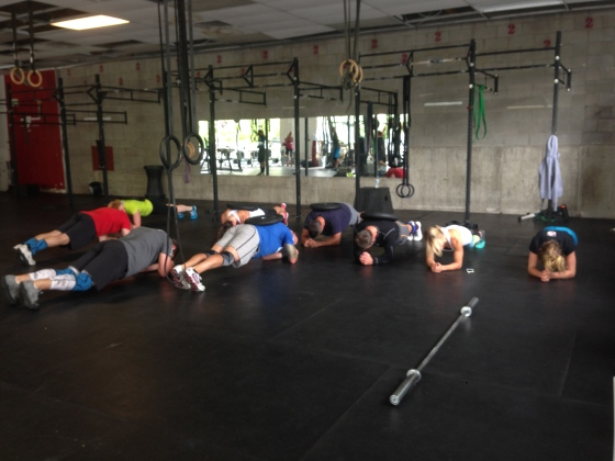 Strength class assuming CrossFit prayer postion.